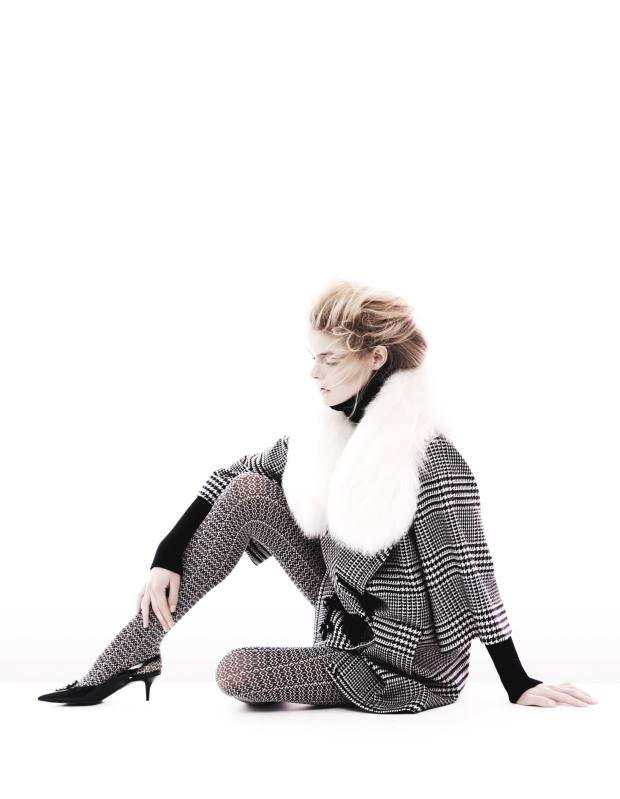 Wool/silk coat with fox collar, €3,000, and wool rollneck jumper, €810, both by Andrew Gn. Polyester-mix tights, £17.75, by Oroblu from MyTights. Chain and leather slingback shoes with ponyskin‑effect houndstooth detail, £520, by Roger Vivier