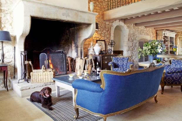 La Bastide de Marie's welcoming reception with its feature fireplace