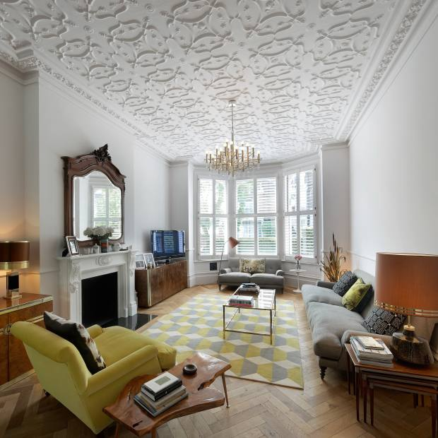 A reception room with decorative ceiling in a Chiswick property, designed