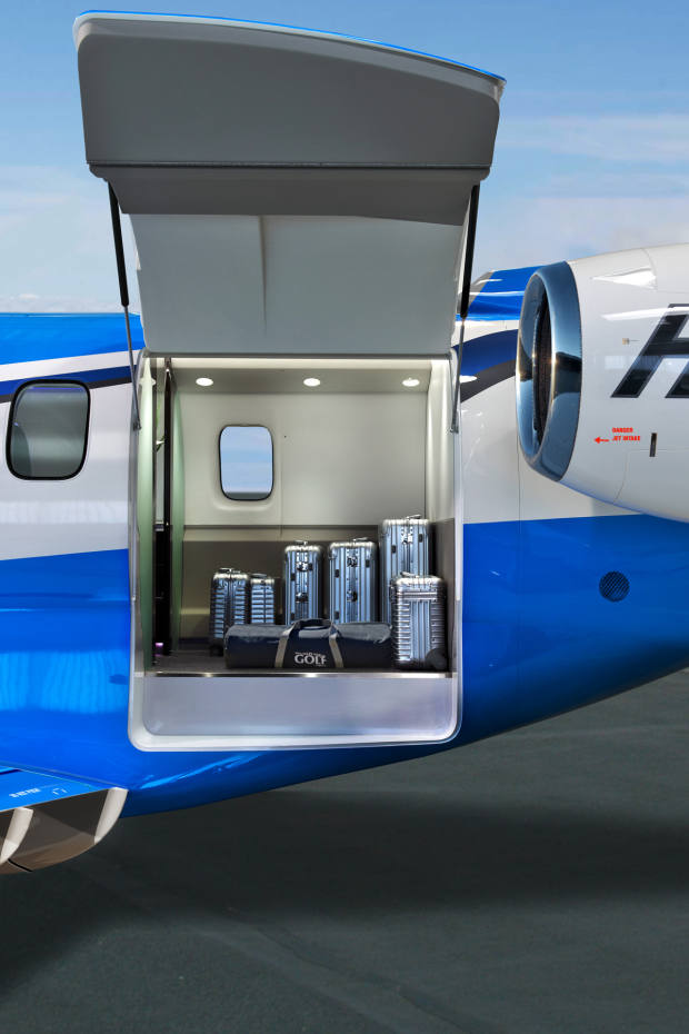The cargo door measures 1.3m wide by 1.25m high, which is rare in a private jet