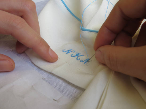 Hand & Lock is a noted specialist in the traditional arts of monogramming, beadwork and subtle silk shading