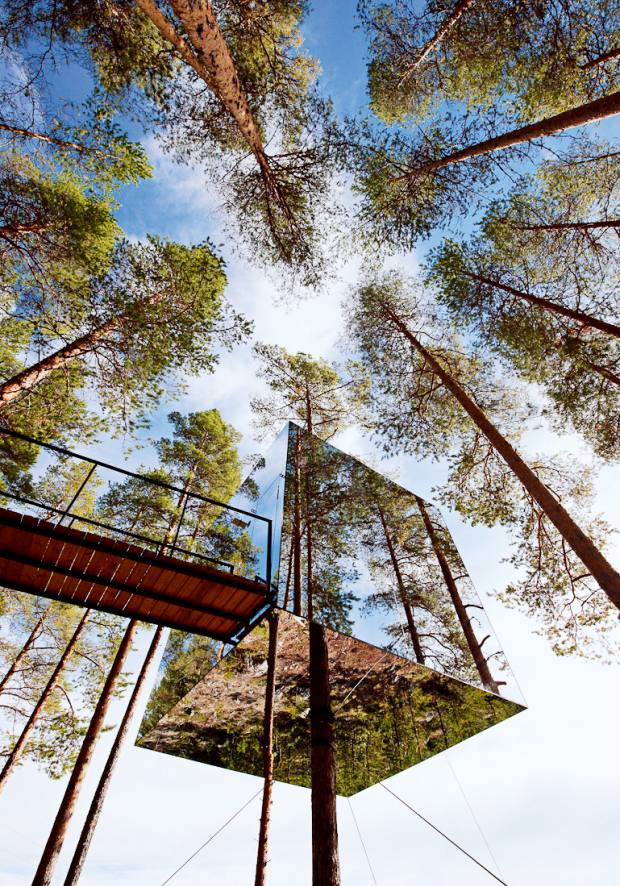 The Mirrorcube, designed by Tham & Videgård for Treehotel in northern Sweden, blends in with the surrounding trees
