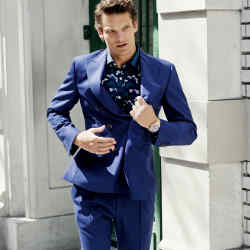 Tod's cotton-mix blazer, £810, matching trousers, £390, and silk shirt, £630. Rolex Oyster Perpetual Submariner gold watch, £22,900. Ring, stylist's own