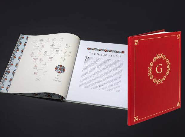 The cover and pages of a Genealogica ancestral encyclopedia