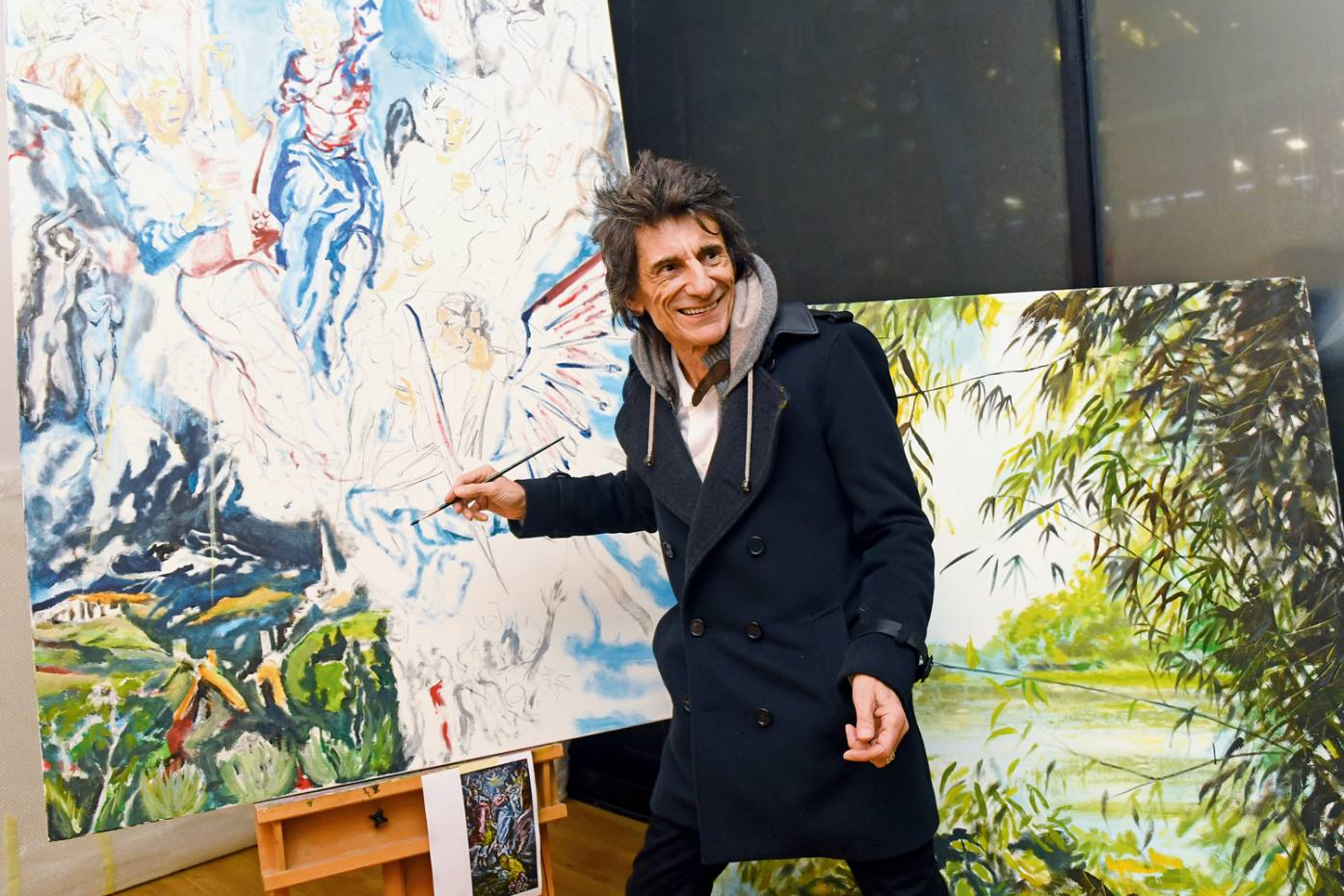 Wood painting ataprivate viewing of the Ronnie Wood Collection exhibition in December 2019