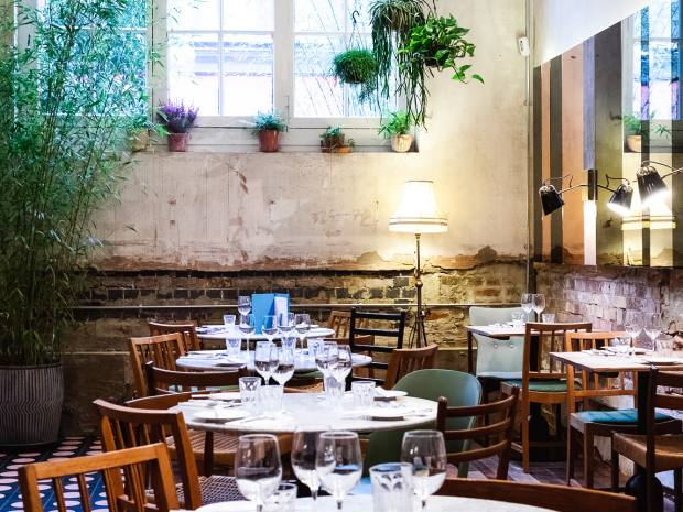 The Shoreditch restaurant's airy industrial interior is set off with greenery
