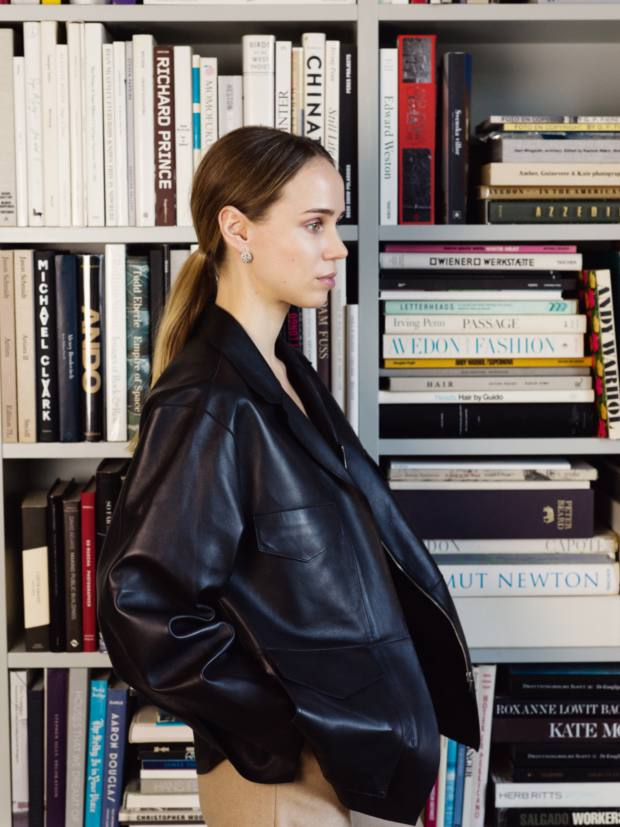Kling in her Stockholm home wearing her Totême leather jacket and a pair of vintage earrings from Kaplans auction house