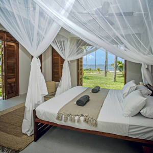 A bedroom at the Beach House, a Balinese-style villa on the Kenyan coast