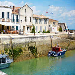 Saint Martin-de‑Ré harbour is ringed with restaurants serving traditional cuisine
