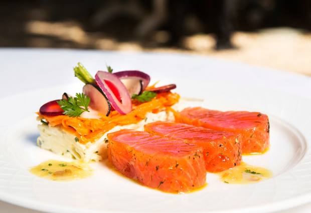 Thick-cut marinated Scottish salmon with black radish and grated Granny Smith is among the starters