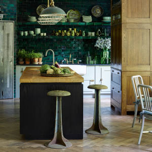 A textured and layered look defines Hubert Zandberg's bespoke kitchens, with features such as industrial-style stools and lighting and distressed oak floors