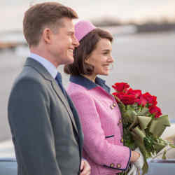 Caspar Phillipson and Natalie Portman in the 2016 film Jackie, with Portman wearing a replica of Jackie Kennedy's classic pink Chanel suit