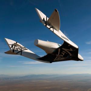 Virgin Galactic's VSS Enterprise gliding above the Mojave desert during a test flight.