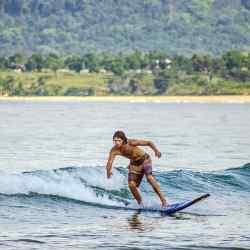 Riding a wave at Bureh Beach