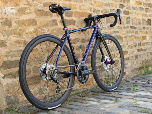 A custom geometry BLK J.ACK II featuring a metallic purple finish, a selection of anodised components and lightweight ÆRA AR 36 wheels