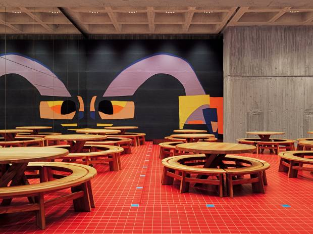 Daniel Silver collages and Pierre Chapo circular tables at the Floragatan kitchen/diner