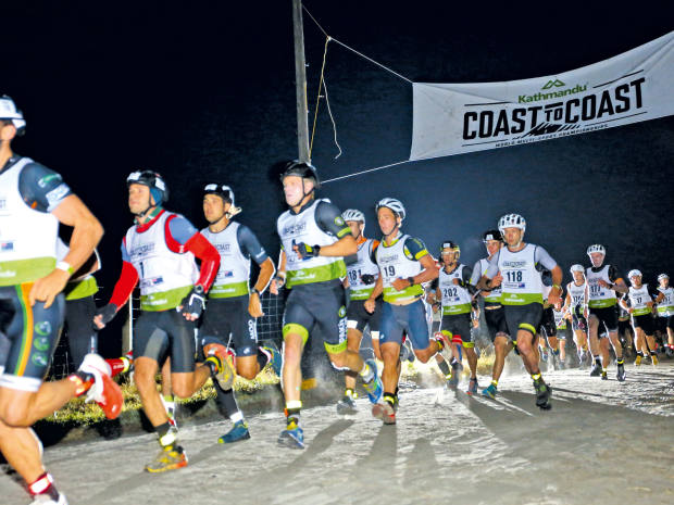 The Coast to Coast begins on Kumara Beach under the cover of darkness