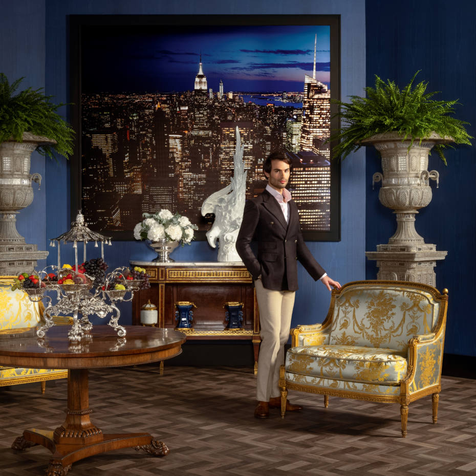 Mark-Francis Vandelli in the New York penthouse scene featuring Louis XVI oil-gilt marquises, £30,000-£50,000, and a Regency rosewood centre table, £4,000-£6,000