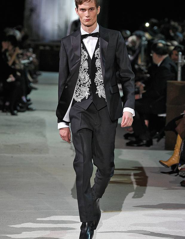 DSquared2 wool/silk Beverley suit, £1,520, embroidered wool waistcoat, £430, cotton shirt, £335, silk bow tie, £90, and leather boots, £540