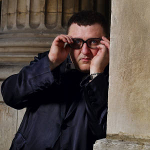 Alber Elbaz outside the Bourse de Commerce de Paris after the presentation of Lanvin's spring/summer 2012 menswear collection.