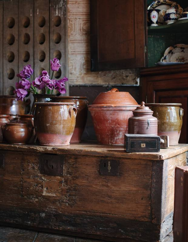 A selection of 19th-century country pottery, price on request, displayed on a Tudor ship's chest, £1,200