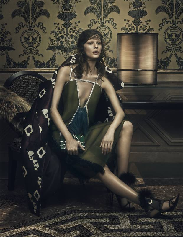Tod's silk-mix coat, £2,720. Prada organza dress with shearling, goat-hair and leather trim, £4,020. Fendi calfskin and fox-fur shoes, £1,100. Nathalie Trad resin clutch bag, £725  Fendi Casa lacquered-wood Augusta armchair from £3,460; fox-fur cushion, £2,810; Macassar-ebony, bronze and glass Dedalo console table, from £6,830; and metal Orione table lamp, from £6,180