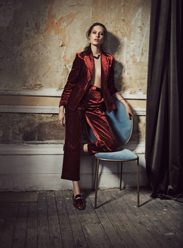 3.1 Phillip Lim velvet blazer, £810, and matching trousers, £580. Tod's leather loafers, £390. Saskia Diez single rose gold wire ear cuff, about £163. Cornelia Webb gold plated brass necklace, £104. Maison Margiela Fine Jewellery gold Split bracelet, £6,300. Alighieri gold plated silver ring, £240. Sé velvet chair, from £1,030. Ralph Lauren Home velvet English Riding fabric, £84 per m