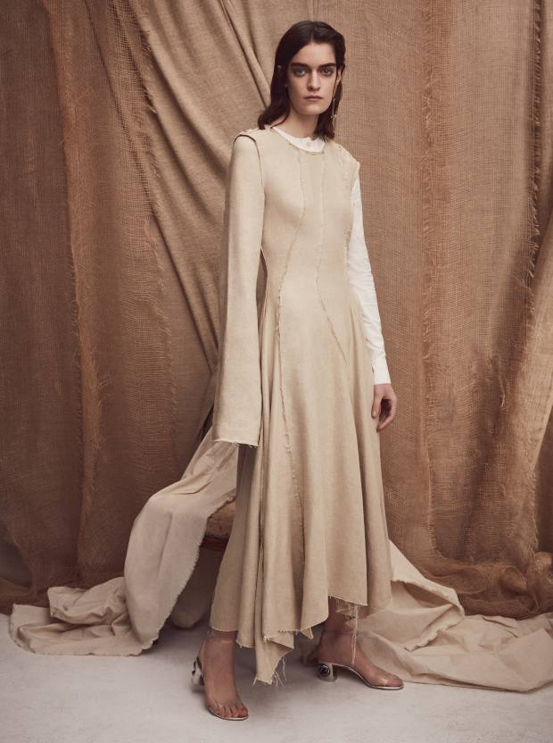 Loewe linen and hemp dress, £1,575. Casadei metal and Perspex sandals, £565. Slim Barrett gold plated silver and glass earring, £680 for pair