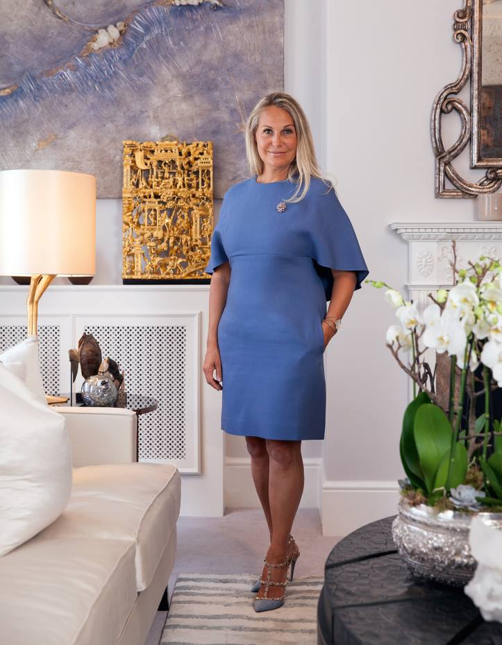 Katharine Pooley at her home in London, wearing a dress by Valentino