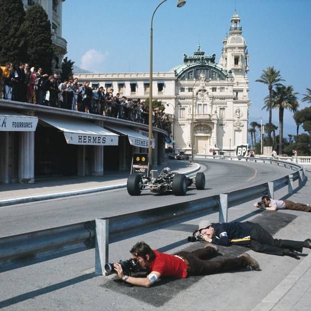 Previously unseen image of photographers at the 1969 Monaco Grand Prix; they are lying next to the steel barriers that had replaced the straw bales of the 1950s on the climb up to Massenet and the Café de Paris