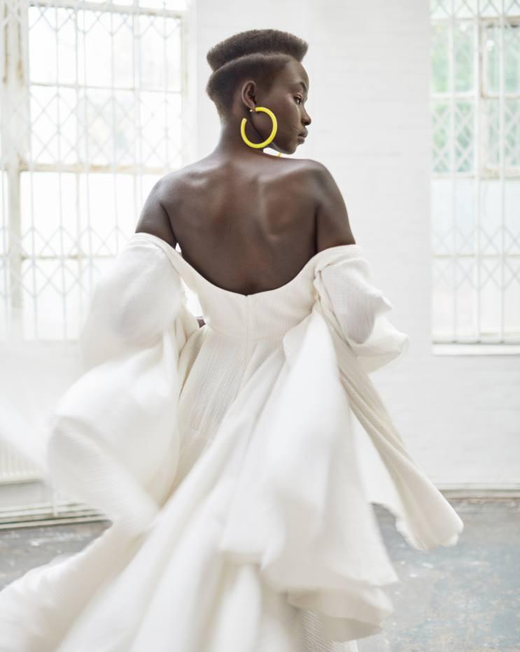 Emilia Wickstead cotton seersucker Amal dress, £1,730. Cult Gaiaacrylic Yellow Quartz earrings, $88