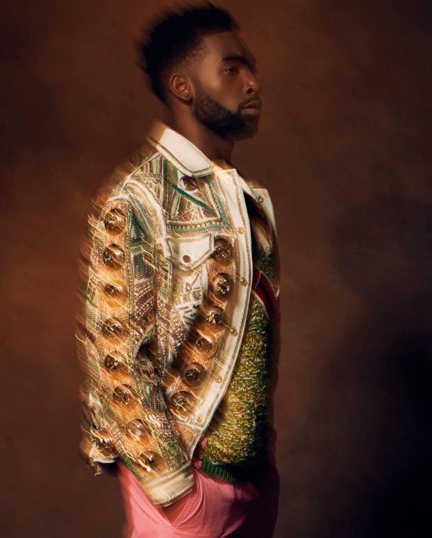 Balmain embroidered denim jacket, about £13,060. Prada wool‑mix gilet, £655. Sacai cotton trousers, £515