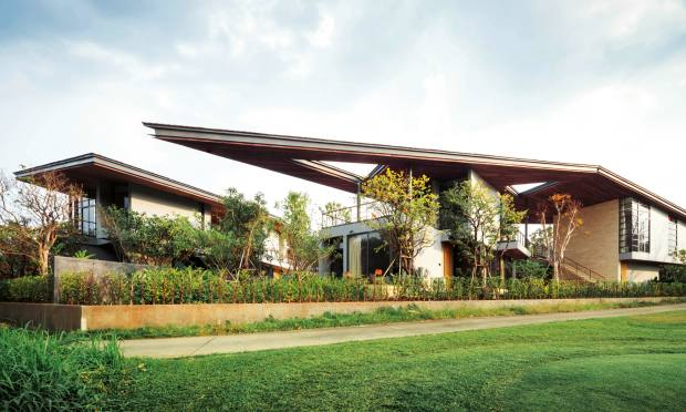 InThailand, dramatic triangular roofs dominate Stu/D/O Architects' design for the Gliding Villa and its guesthouse