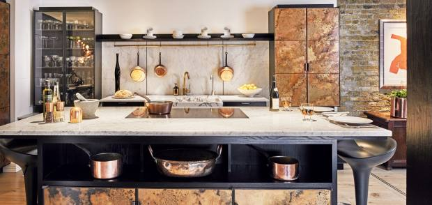 Ledbury Studio's Metallics Collection kitchen, from £50,000, features copper door panels with a verdigris pattern, aswell as black-stained ash cabinetry and marble worktops and splashback