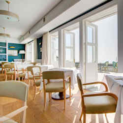 The Seaside Boarding House's restaurant and terrace possess a relaxed yet elegant atmosphere