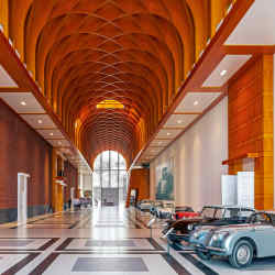 The Great Hall of the Louwman Museum, with (left) 1941 Tatra 87 and (right from front) 1952 Jaguar XK120 Fixed Head Coupé, 1958 Citroën DS19, 1968 Toyota 2000GT, 1966 Chevrolet Corvette 427 Stingray, 1952 Volvo PV444 CS, 1986 Shanghai SH760, 1952 Volvo PV444 CS