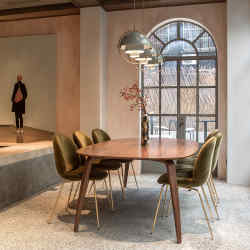 GamFratesi's Beetle chairs surround a marble-topped table in Shanghai's Gubi House