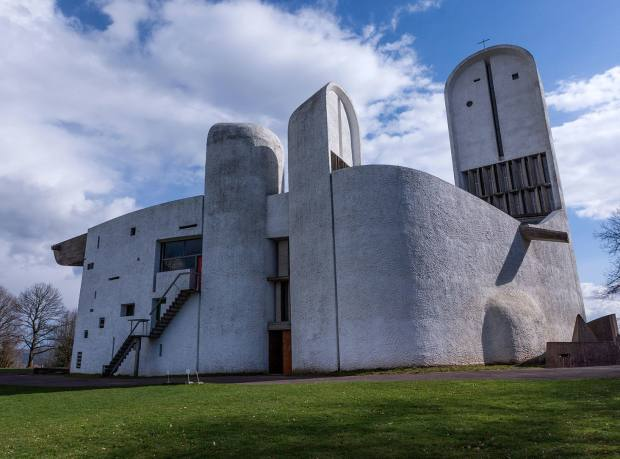 Back view of the Chapel of Notre Dame du Haut in Ronchamp designed by the Franco-Swiss architect Le Corbusier