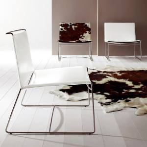 Fil fireside chair in synderme-leather composite, £602, in cowhide, £877, in wool-felt, £606