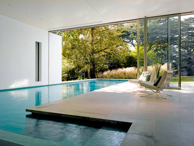 Munkenbeck+Partners brought the idea of floating to a private residence in north London with an indoor/outdoor swimming pool