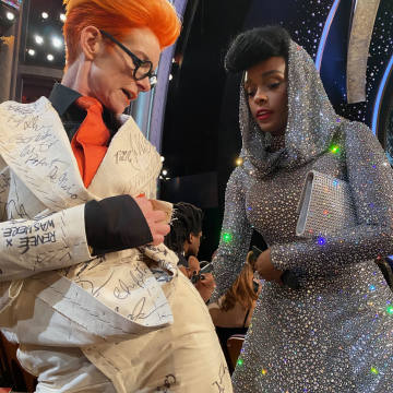 Sandy Powell with Janelle Monáe signing her suit at the 2020 Oscars
