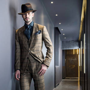 Cifonelli windowpane-check three-piece suit, €3,400