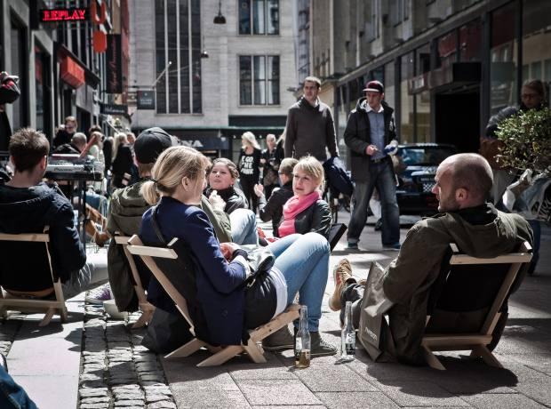Relaxing in front of Samsøe & Samsøe's shop.