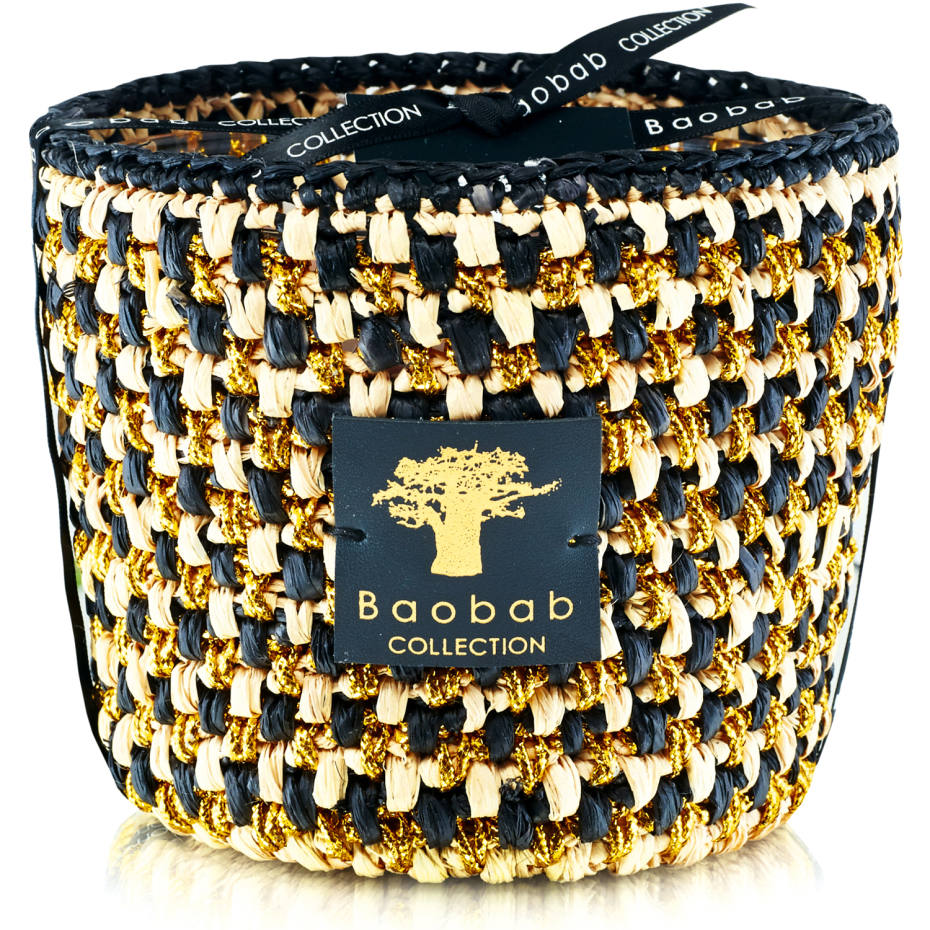 Scented candle, from £92; five per cent of the proceeds from all Modernista Raffia candles goes to the Malagasy cooperative