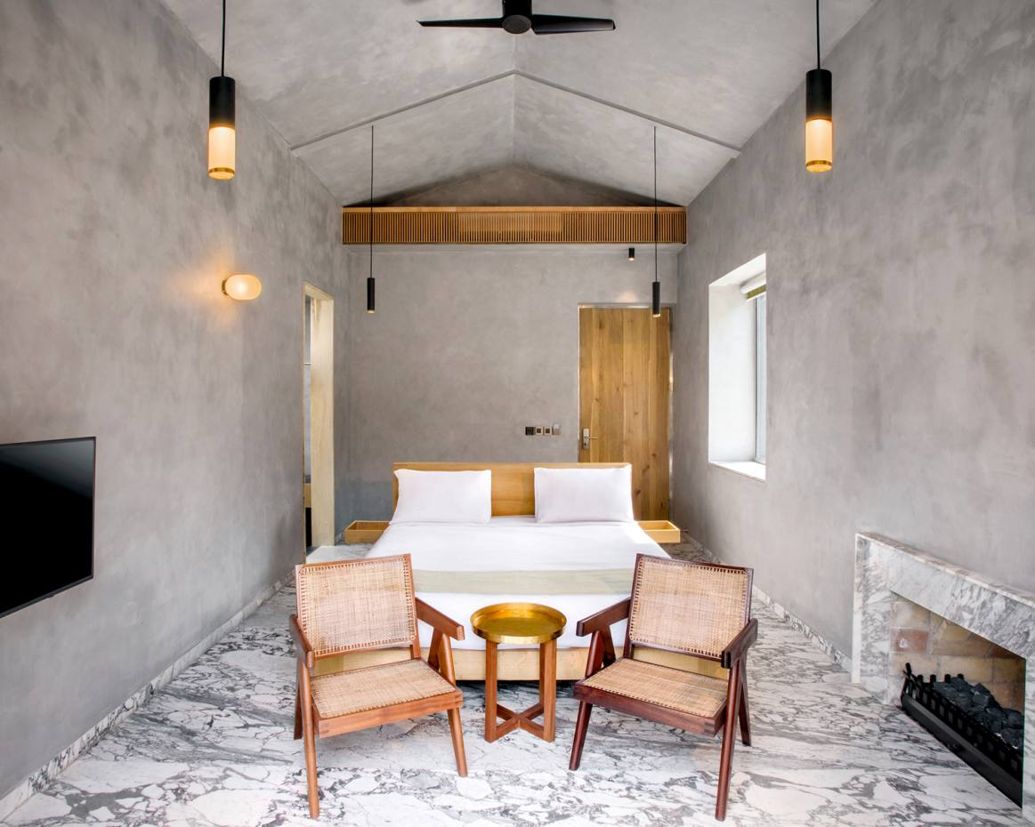 One of the stylishly minimalist cottage bedrooms at TheRoseate Ganges, in Rishikesh, India