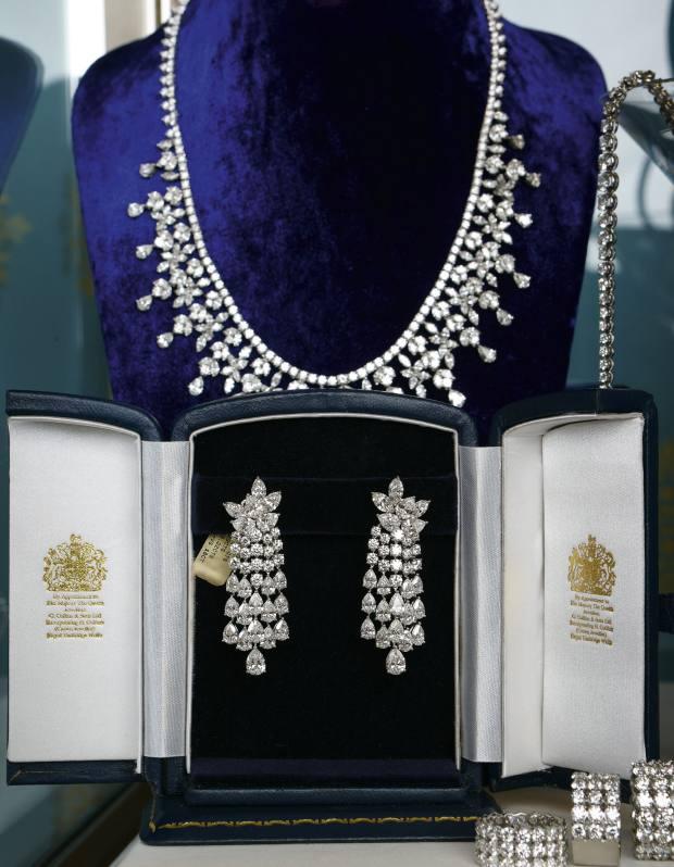 round brilliant-cut diamond line necklet and necklet of pear, marquise and round brilliant-cut diamonds. Marquise and pear diamond drop earrings, £79,000.