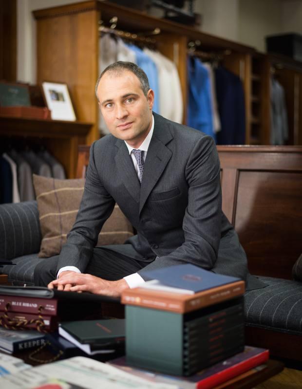 Ben Goldsmith at Huntsman, Savile Row, wearing a Huntsman worsted herringbone three-button, single-breasted suit