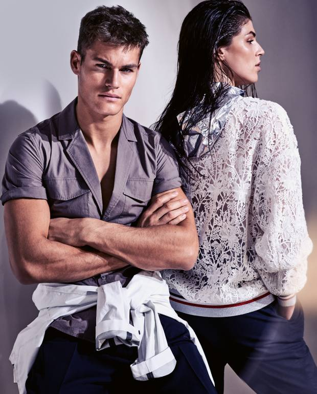 He wears Bottega Veneta cotton shirt, £570, and cotton gabardine trousers, £615. CP Company ultra-light cotton jacket, £350. She wears Moncler Gamme Rouge embroidered silk jacket, price on request. Margaret Howell linen trousers, £310