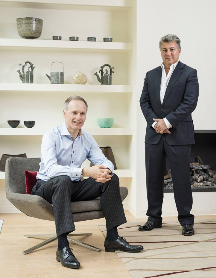 Collector Charles Pridgeon, seated, and ceramics dealer Adrian Sassoon at Pridgeon's west London home with a c1740 Meissen bowl (top shelf) and contemporary works by Rupert Spira, Walter Keeler and Kate Malone, among others