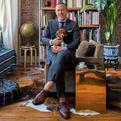 Scott Schuman at home in New York with his beagle Charlie